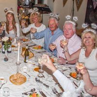 Friends seated around table to celebrate 60th birthday party at The White House in Crosthwaite, Cumbria