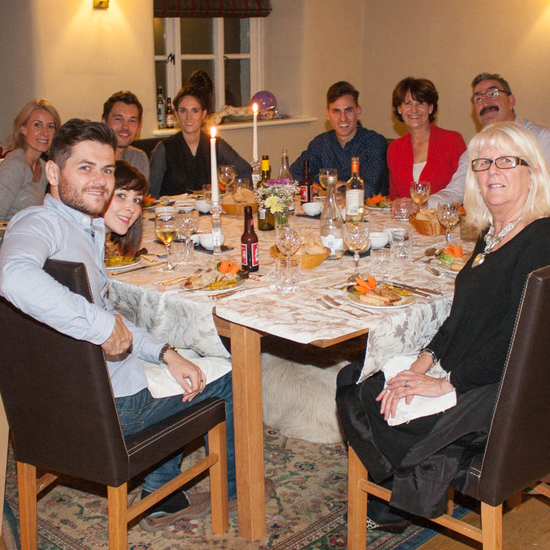 Group of people sat around table for dinner party at The White House in the Lakes