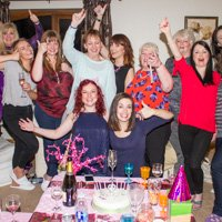 Group of girls throw their arms in the air and cheer at Laura's hen party Simgill Farm