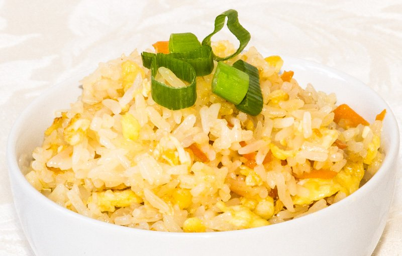 Egg Fried Rice (khao-pad-kai). Egg and vegetables stir-fried with rice. A meal in itself