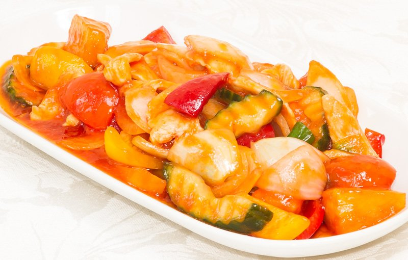 Sweet & Sour Chicken ผัดเปรี้ยวหวาน (Pad Priaw Waan). Tender pieces of chicken stir-fried with onions, courgette and pineapple