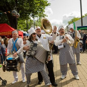 a group of street musicians, performers at bolton food and drink festival