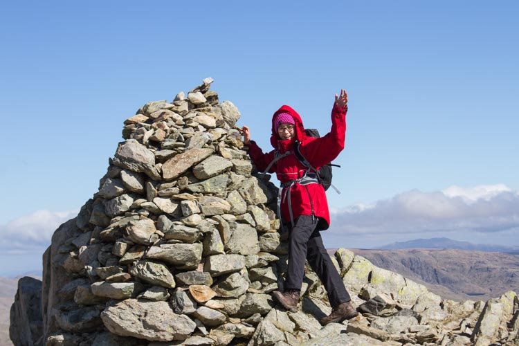 Hannah by the summit cairn on Swirl How