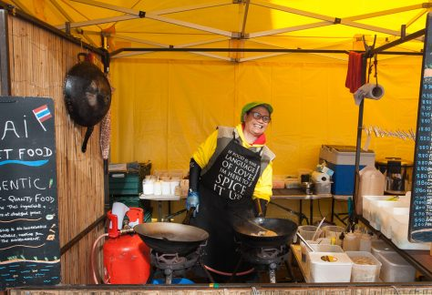 thai chef cooking on a street food stall