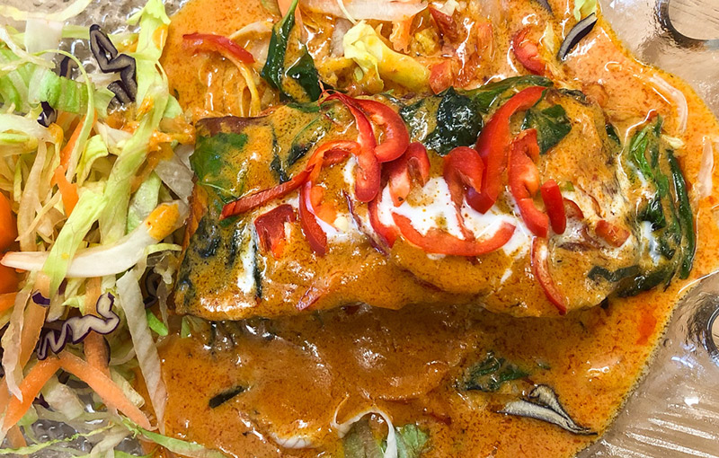 A dish of salmon chu chi, a thai stiry fry dish from our thai takeaway menu
