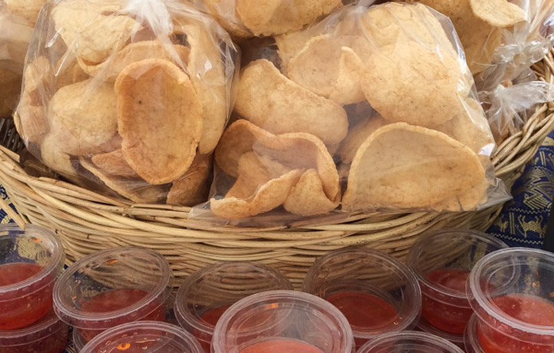 A basket of Thai prawn crackers with sweet chilli dips from our thai takeaway menu