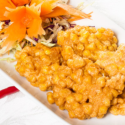 Thai corn fritters served on a plate, from our Thai takeaway menu