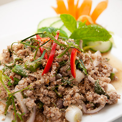 A dish of Laap, a spicy Thai salad with minced pork, ground rice, mint and cucumber