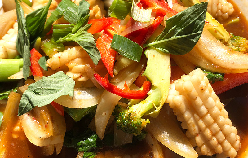 A dish of Thai squid stir fry, Pla Meuk Prik Pao from our takeaway menu