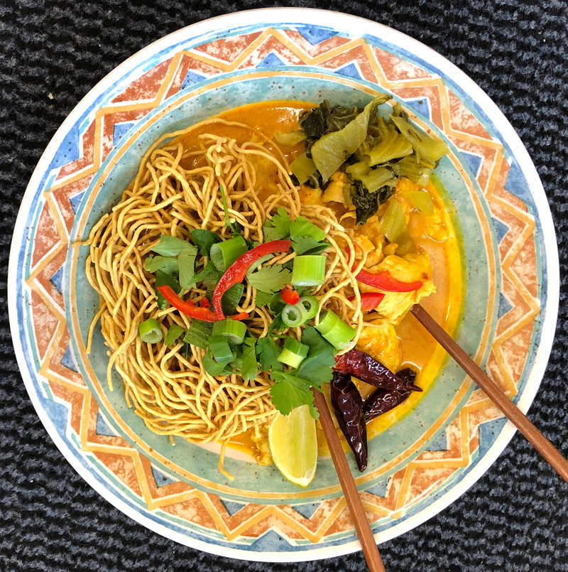 A bowl of Khao Soi, a northern Thailand noodle dish