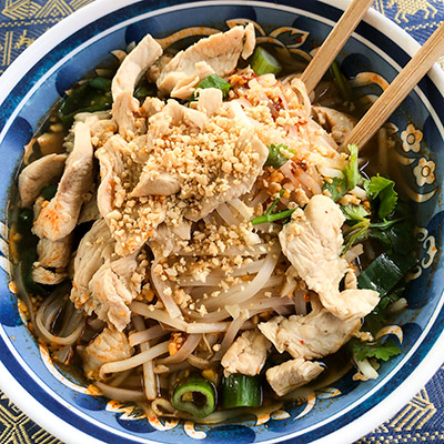 A bowl of Guay Tiew, Thai noodles with chicken