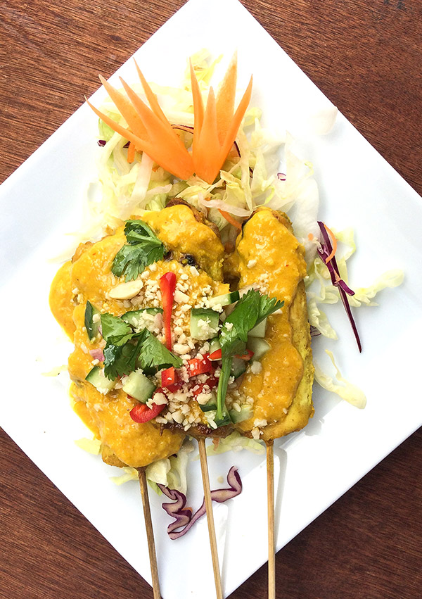 A dish of Thai tapas from Thai Kitchen in Kendal, chicken satay on skewers