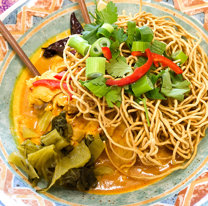 A bowl of Khao Soi, Thai noodle dish from northern Thailand on our menu at Thai Cafe in Kendal