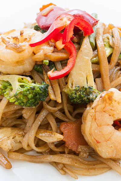 A plate of Thai Pad Kee Mao, also known as drunken noodles