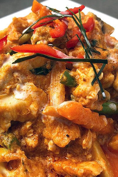 A plate of chicken Hor Mok Curry, a mild dish with vegetables and coconut