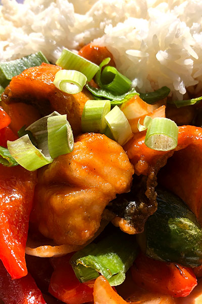A plate of Thai Sweet and Sour with jasmine rice and vegetables